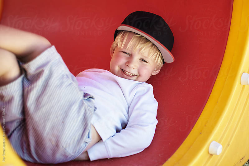 Smiling boy at playground by Per Swantesson for Stocksy United