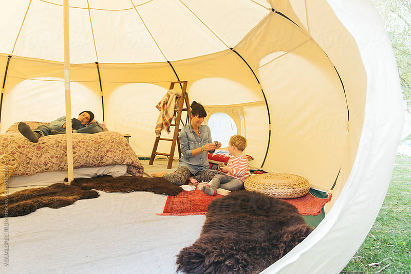 Family Camping - Caucasian Mother Playing With Her Son in Spacious Circular Tent by VISUALSPECTRUM for Stocksy United