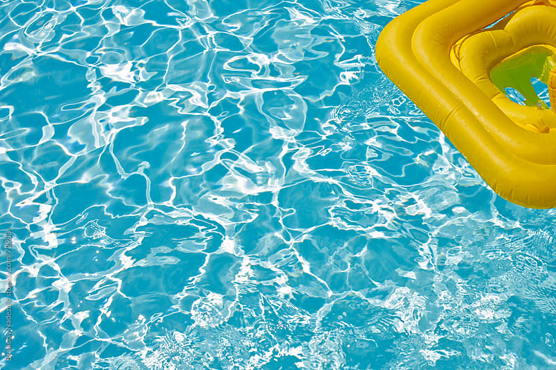 Yellow rubber float in the pool by Bratislav Nadezdic for Stocksy United