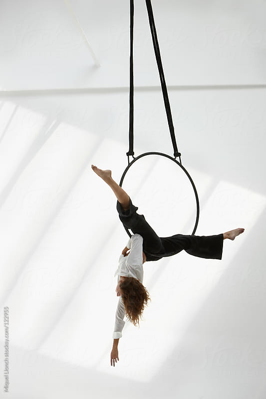 Acrobatic woman with metal hoop by Miquel Llonch for Stocksy United