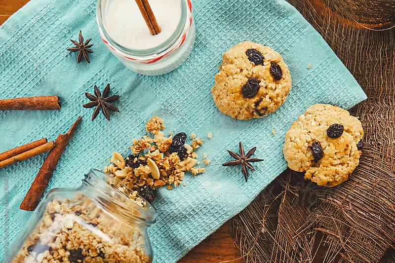 Oat cookies, milk with cinnamon and jar of oats served on table. by Marija Savic for Stocksy United