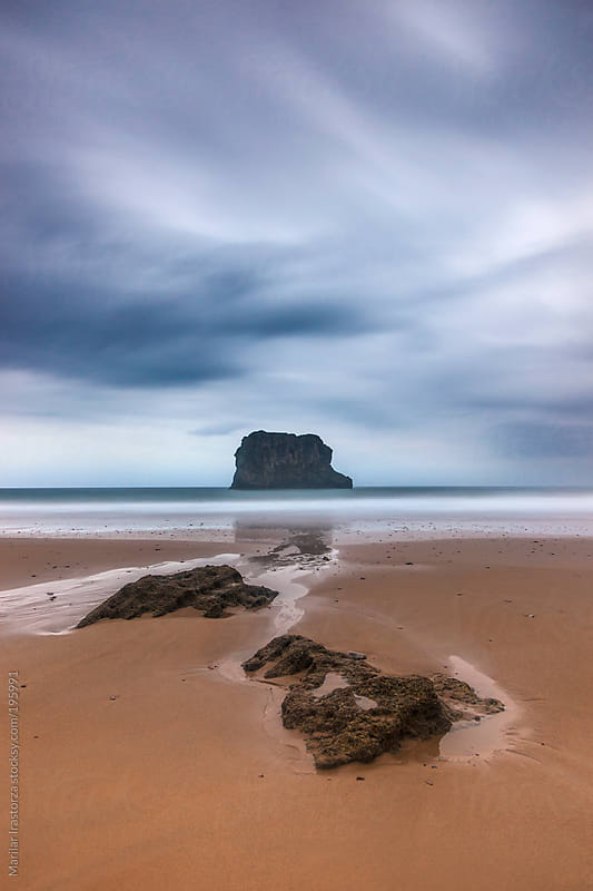 Asturian coast beach in the north of Spain, on a drizzly morning by Marilar Irastorza for Stocksy United