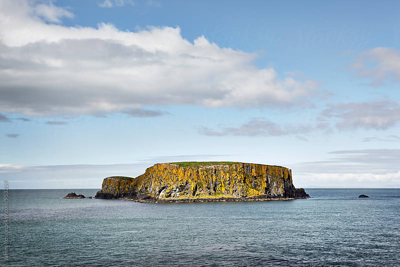 A remote island surrounded by sea by James Ross for Stocksy United