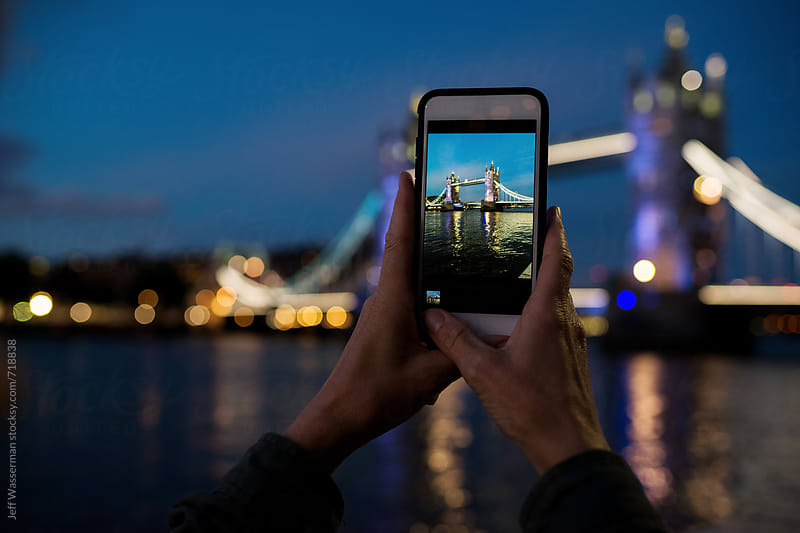 Tourist Taking Photo of Tower of London with Cellphone by Jeff Wasserman for Stocksy United