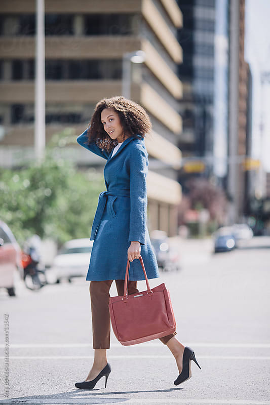 A business woman crossing the street by Ania Boniecka for Stocksy United