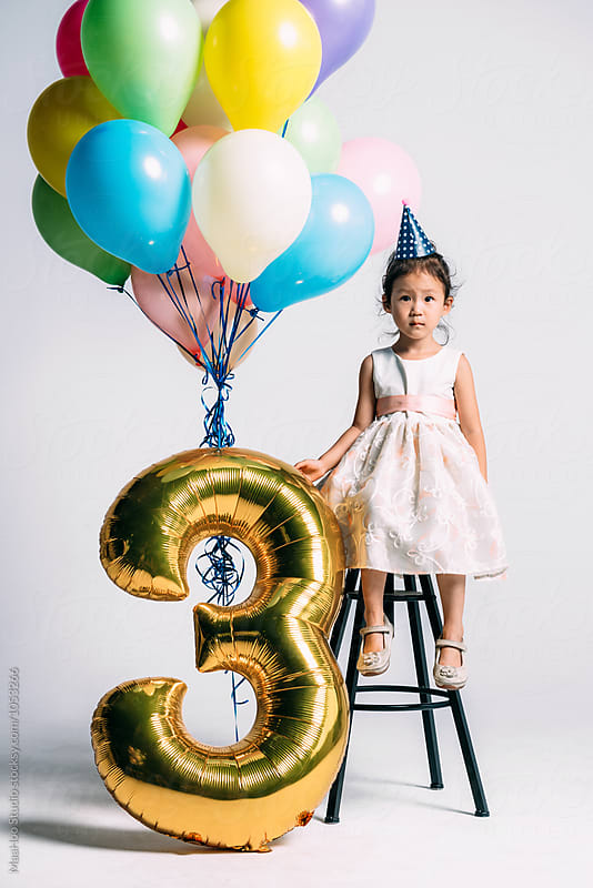 Adorable little girl at her three years birthday party by Maa Hoo for Stocksy United