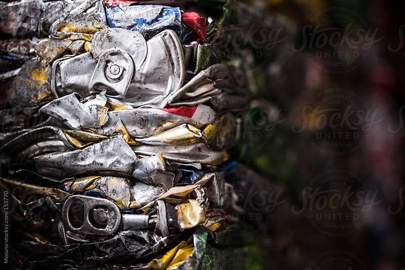 Squashed Tins in a Recycling Factory by Mosuno for Stocksy United
