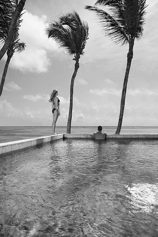 Couple relaxing at the pool at luxury resort by Trinette Reed for Stocksy United