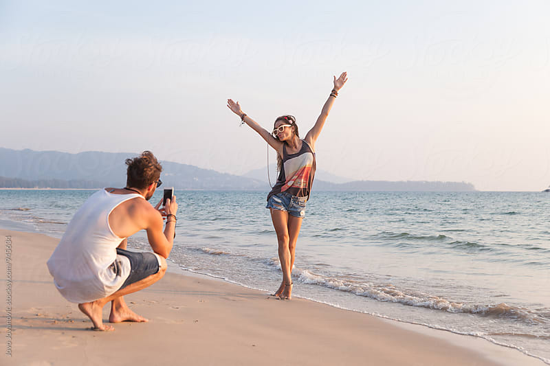 Capturing the moment - taking a photo at the beach by Jovo Jovanovic for Stocksy United