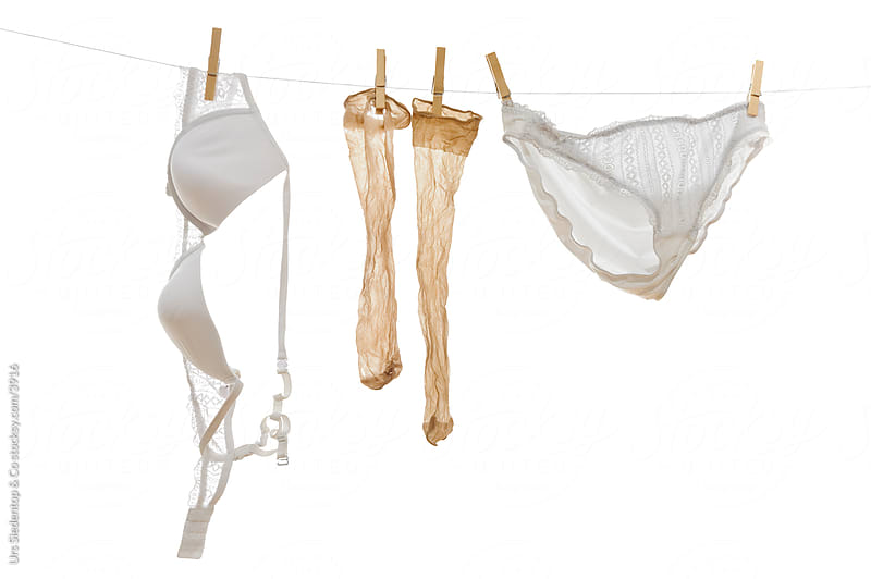Underwear - bra, stockings and  pants on clothline by Urs Siedentop & Co for Stocksy United