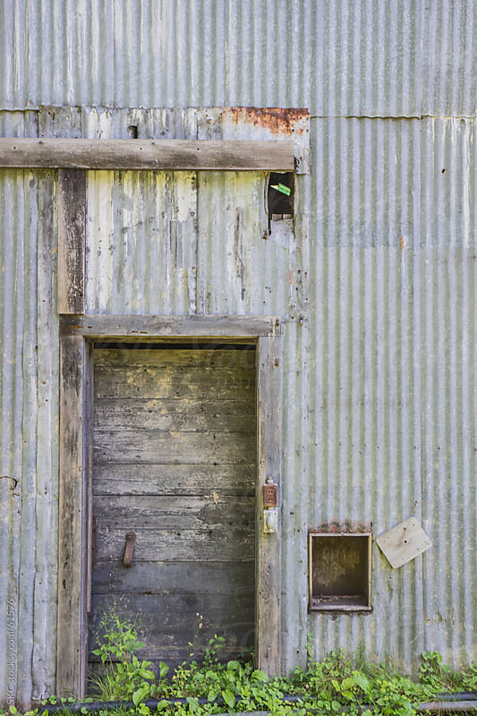 Wooden Door on Metal Shack by suzanne clements for Stocksy United