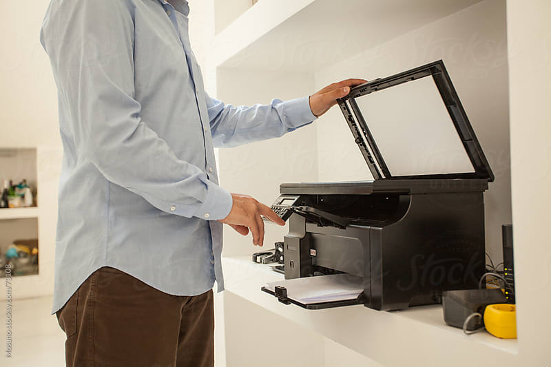 Anonymous Man Using Printer by Mosuno for Stocksy United