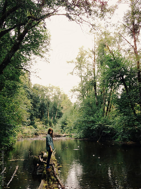 Woman on Forested Creek by Kevin Russ for Stocksy United