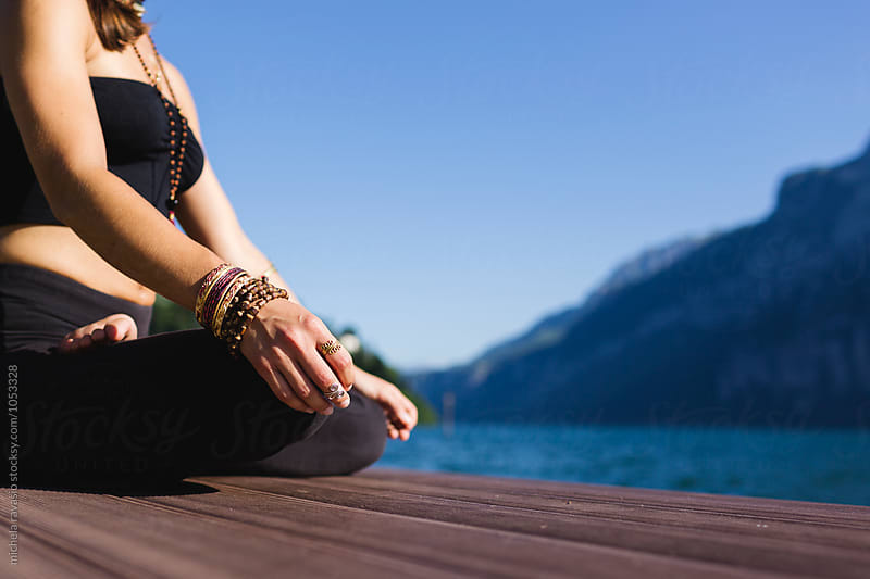 Woman doing lotus position by michela ravasio for Stocksy United