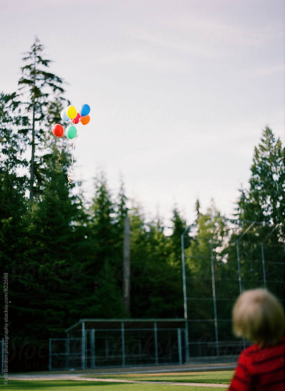 balloons in the sky by Kirill Bordon photography for Stocksy United
