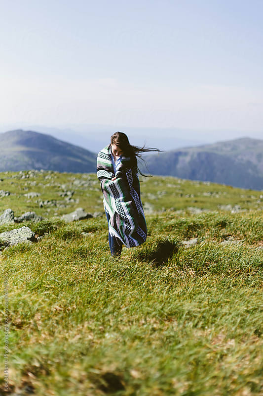 Young woman walking on a mountain top by Joe St.Pierre Photography for Stocksy United