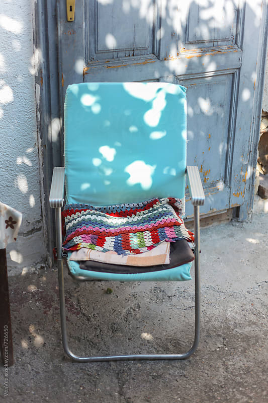 Vintage chair in a countryside backyard  by VeaVea for Stocksy United