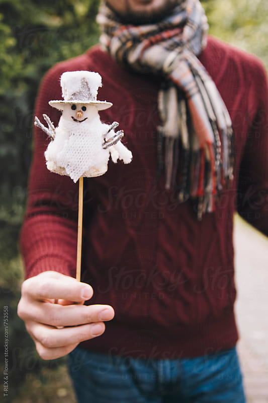 Man's hand holding snowman by Danil Nevsky for Stocksy United