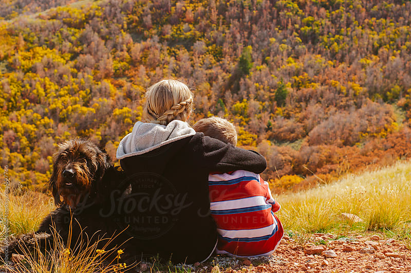 brother and sister enjoying autumn mountains by Rebecca Rockwood for Stocksy United