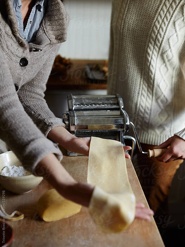 Two friends making homemade pasta in the kitchen by Trinette Reed for Stocksy United