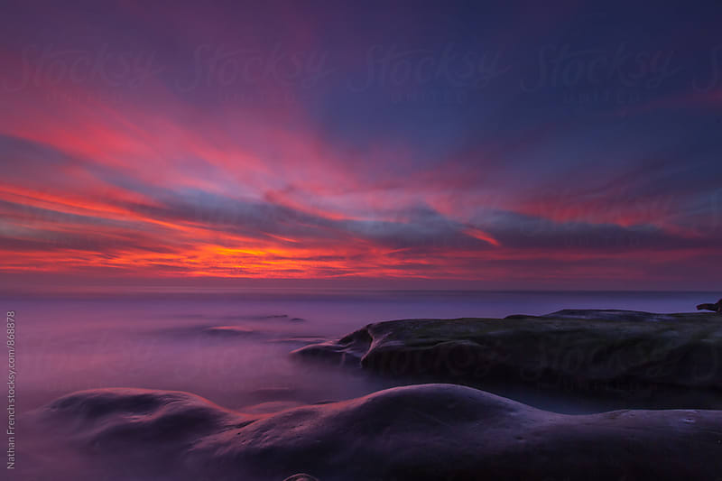 Misty Ocean Sunset  by Nathan French for Stocksy United