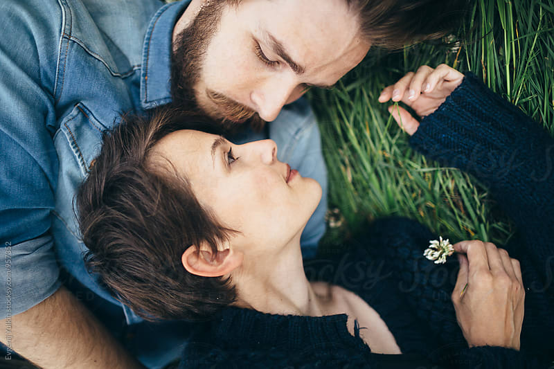 Young couple laying on the grass by Evgenij Yulkin for Stocksy United