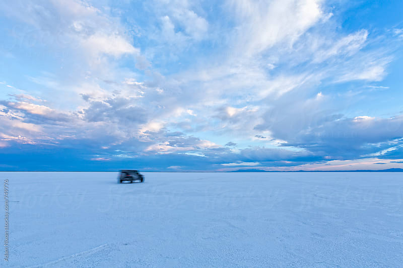 Off road vechile racing by on Bonneville Salt Flats, Utah by Adam Nixon for Stocksy United