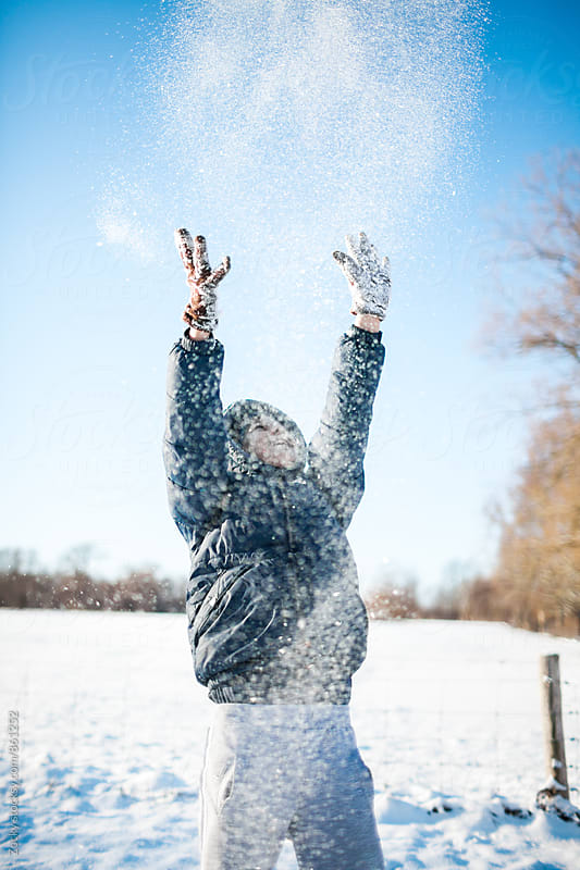 Boy playing with snow by Zocky for Stocksy United
