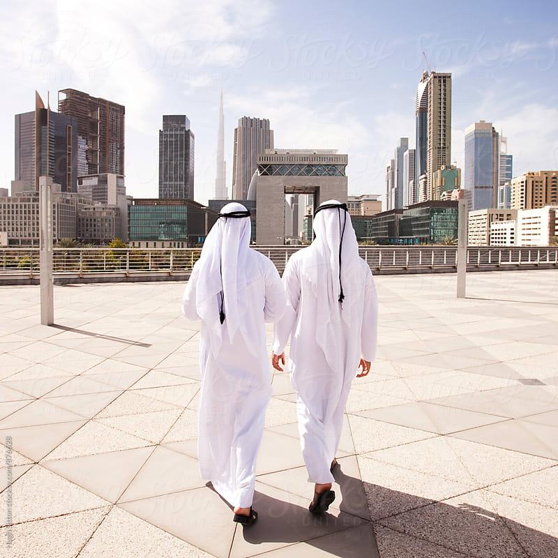 Traditional dressed Arab businessmen. Dubai. U.A.E by Hugh Sitton for Stocksy United