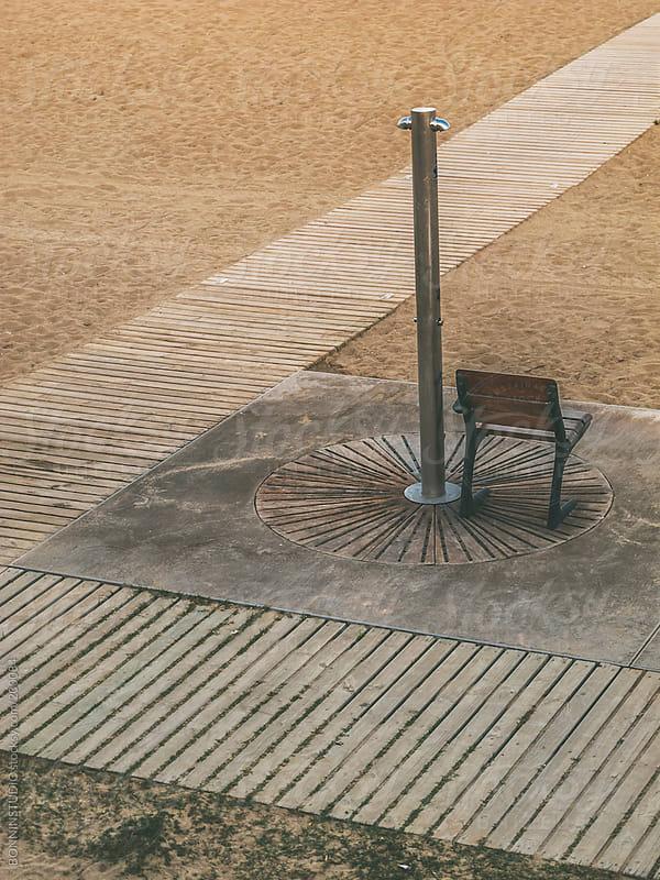 Chair under a beach shower. Barcelona, Spain. by BONNINSTUDIO for Stocksy United