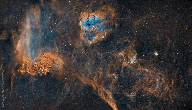 The Tadpoles and Flaming star nebula by Sara Wager for Stocksy United