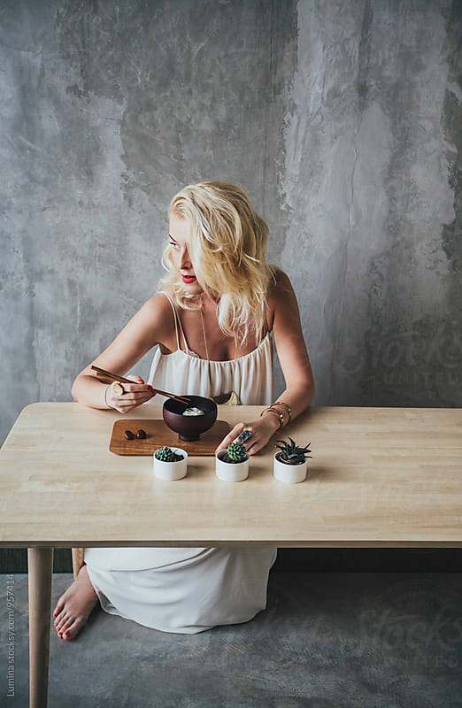Woman Eating Ice Cream by Lumina for Stocksy United
