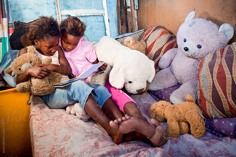 African kids reading by Micky Wiswedel for Stocksy United