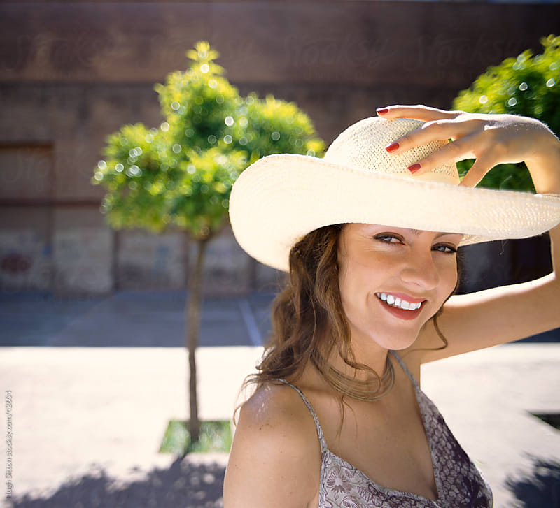 Smiling woman wearing cowboy hat. by Hugh Sitton for Stocksy United