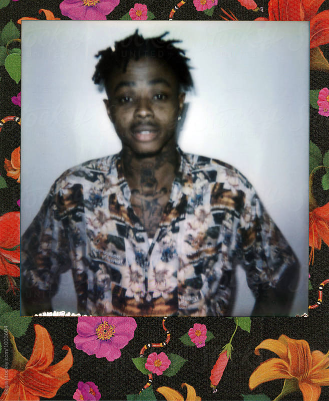 Polaroid of a tattooed black man by kkgas for Stocksy United