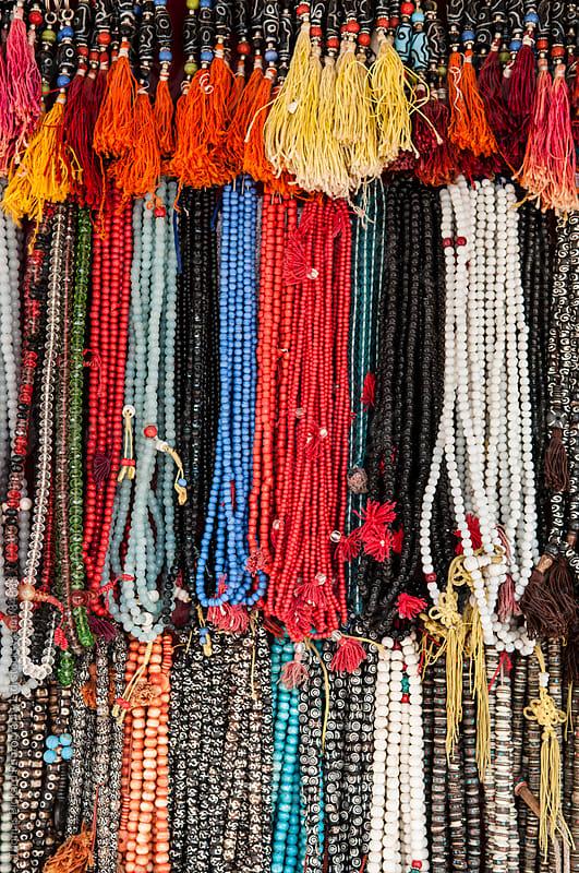 Beads for sale near Bodhnath Stupa, Kathmandu, Nepal. by Thomas Pickard for Stocksy United