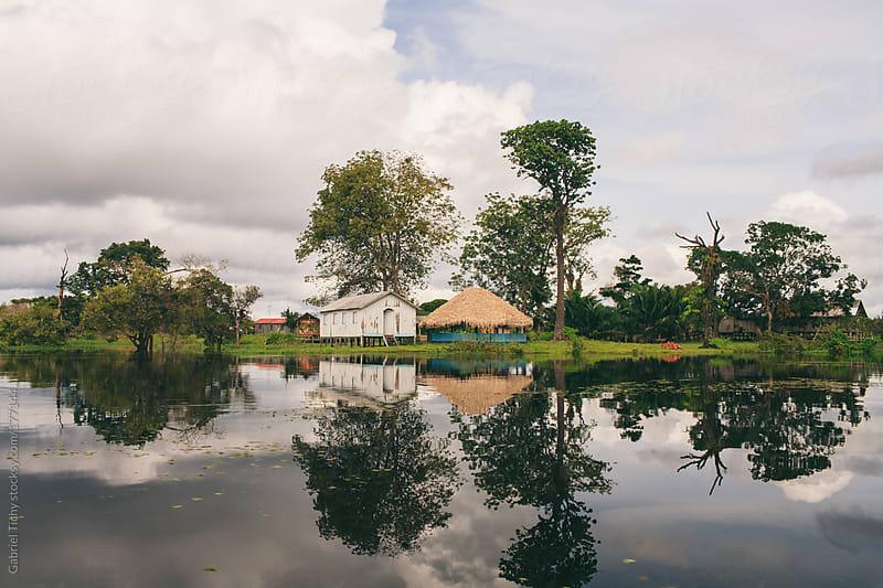 Traditional lodges along Rio Juma by Gabriel Tichy for Stocksy United