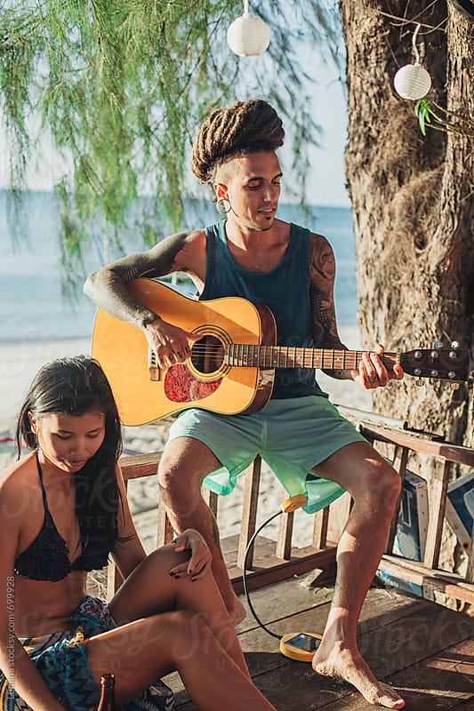 Man Playing the Guitar at the Beach by Lumina for Stocksy United
