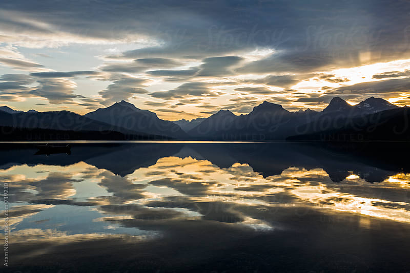 Sunrise Lake McDonald, Glacier National Park by Adam Nixon for Stocksy United