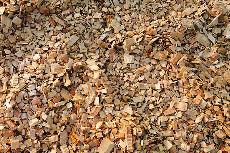 Close up of wood chips from lumber mill by Paul Edmondson for Stocksy United