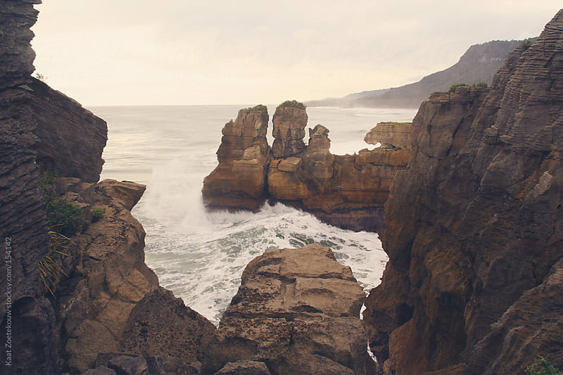 A late afternoon wave crashing into the Punakaiki Pancake Rocks, New Zealand by Kaat Zoetekouw for Stocksy United