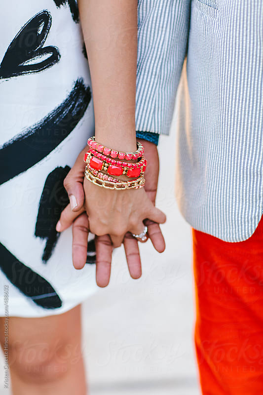 Close-up of a couple holding hands outdoors  by Kristen Curette Hines for Stocksy United