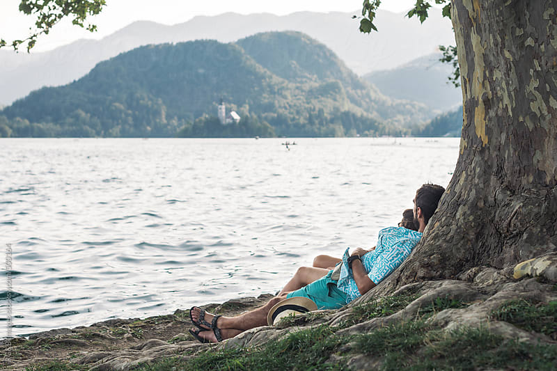 young couple on the lake side  by RG&B Images for Stocksy United