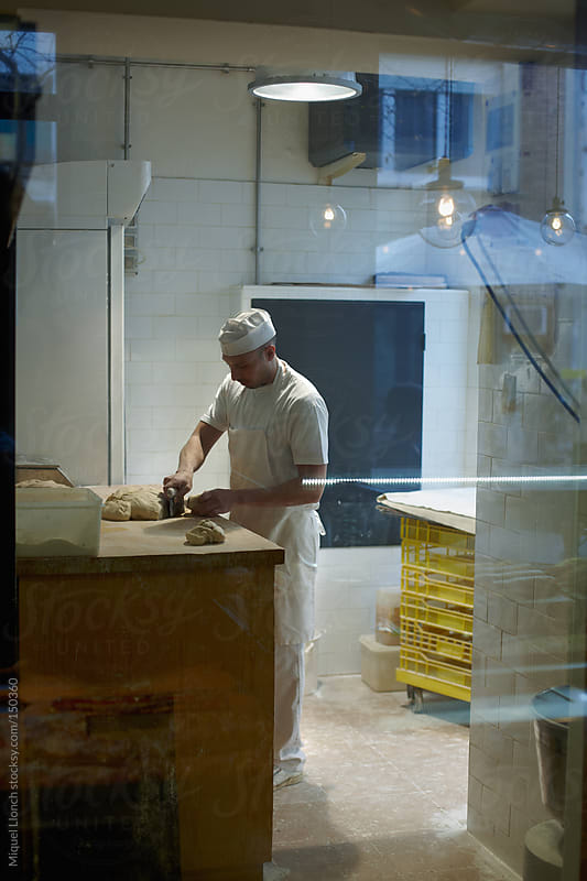 Baker at work by Miquel Llonch for Stocksy United