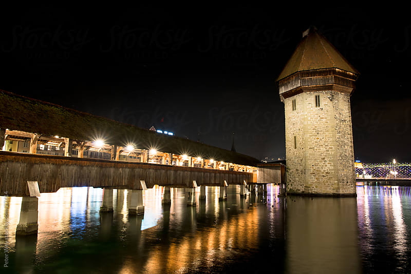 Chapel Bridge in Luzern at night by Peter Wey for Stocksy United