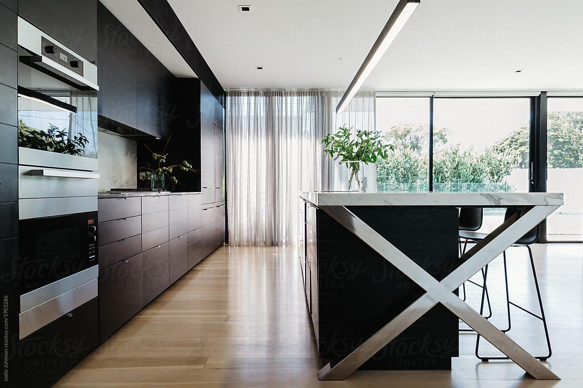 Stunning Black Designer Kitchen With Large Glass Sliding Doors