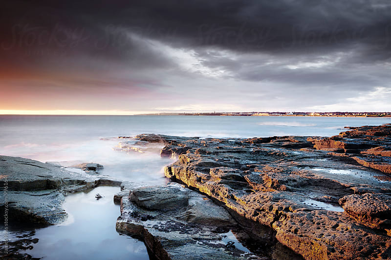 Rocky coastline at dawn by James Ross for Stocksy United