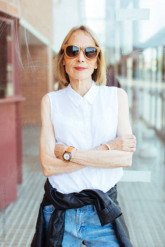Portrait of a stylish senior woman on the street. by BONNINSTUDIO for Stocksy United