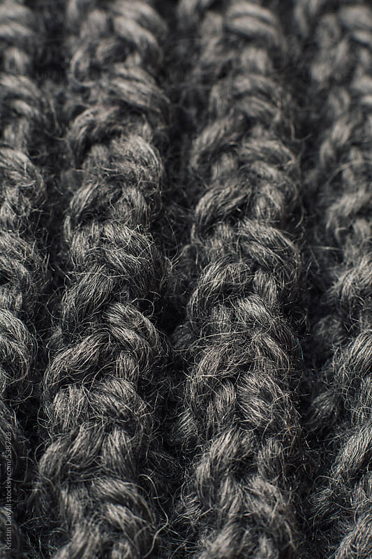 Close up detail of scarf, rows of knitted grey wool yarn by Kristin Duvall for Stocksy United
