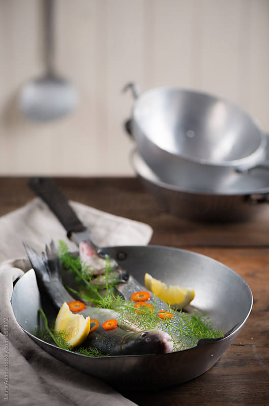 sea bass with wild fennel by Laura Adani for Stocksy United